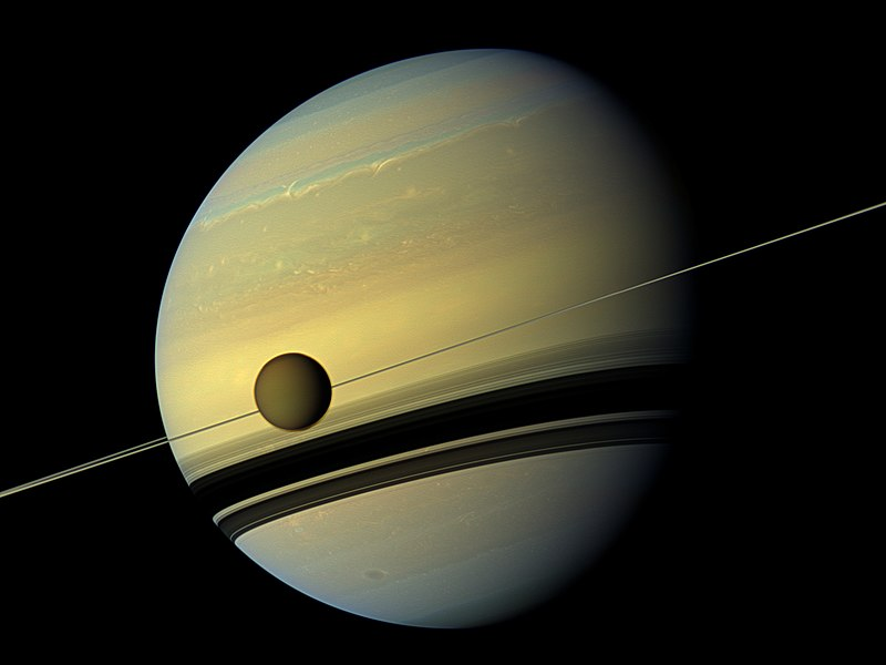 800px-Titan_in_front_of_the_ring_and_Saturn_(cut).jpg